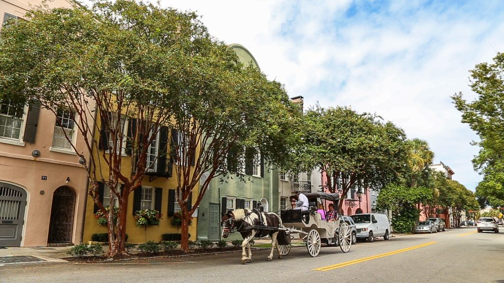 A horse-drawn carriage on Rainbow Row in Charleston